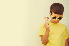 image of gelato  - Young kid eating gelato ice cream - JPG