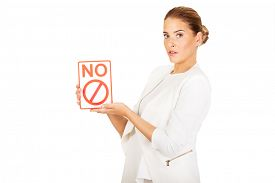 foto of bans  - Young businesswoman holding a board with ban - JPG