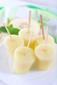 pic of lolli  - Melon ice lolly on table - JPG