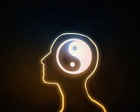 image of yin  - Human head with yin yang icon on dark background  - JPG