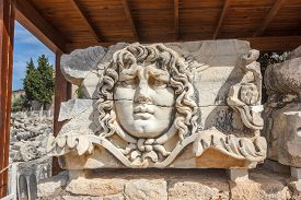 foto of medusa  - Part architrave with frieze with mythical giant Gorgon Medusa head in ancient Temple of Apollo in Didim Turkey - JPG