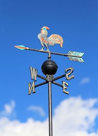 stock photo of wind vanes  - vintage wind vane for measuring wind direction with the cardinal points - JPG