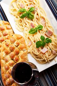 picture of carbonara  - Spaghetti carbonara with ciabatta bread and a glass of red wine - JPG