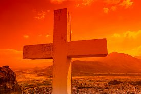 stock photo of trinity  - Famous lookout with large white cross overlooking the city of Kalambaka at sunset from the Monastery of the Holy Trinity - JPG