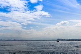 stock photo of marines  - blue sea and blue sky with clouds in the marine reserve - JPG