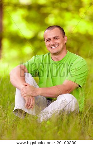 Young Man Relaxing In The Forest