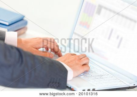 Businessman working on laptop. Close-up