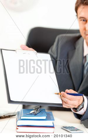 Businessman giving document and pen for signing. Closeup