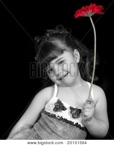 Close-up Of Girl In Ballet Outfit Holding Flower. isolated