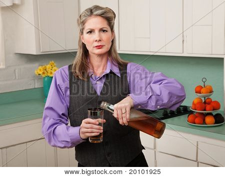 Woman In Drag Pouring A Drink