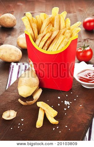 French Fries In Red Paper Bag.
