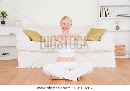 Beautiful Blond-haired Woman Practicing Yoga