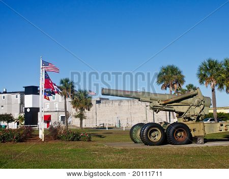 Old Howitzer At Fort With Flags