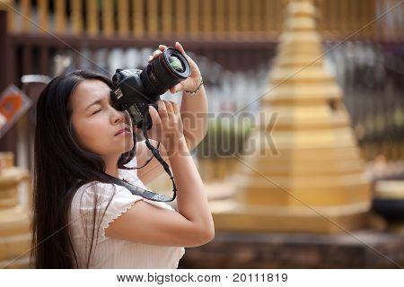 Woman Shooting Photo