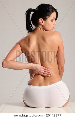 Massage Lower Back Pain For Semi Nude Young Woman