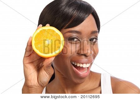 Happy Smiling Young Black Woman With Orange Fruit