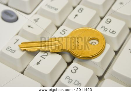 Golden Key On Computer Keyboard
