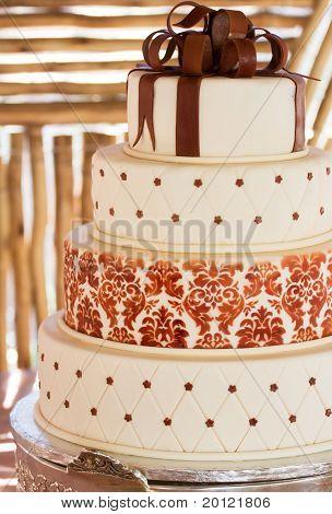 Layered White Wedding Cake With Chocolate Detail