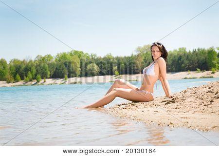 Summer Beach Stunning Woman Sitting In Sand