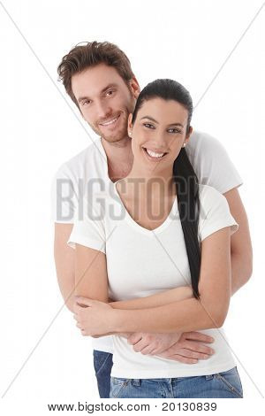 Portrait of happy young couple, hugging, smiling.?