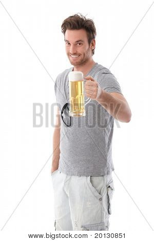 Handsome young man drinking beer, smiling.?