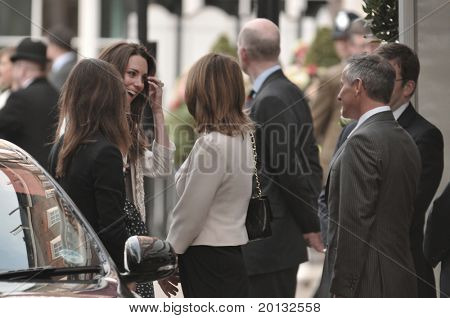 LONDON, ENGLAND - APRIL 28: Kate Middleton (far left, smiling) arrives at the Goring Hotel on the evening before her wedding to Prince William on April 28, 2011 in London England.