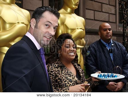 NEW YORK - MARCH 4: Actress/Comedian Sherri Shepherd and Stephane Lacroix (L) welcomes two 8-foot golden statues at the New York Palace Hotel for the official New York Oscar night celebration on March 4, 2010 in New York.