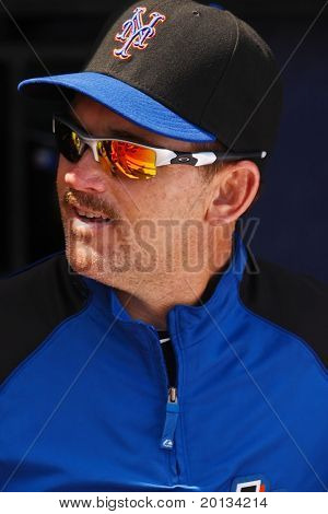 PORT ST. LUCIE, FLORIDA - MARCH 23: New York Mets hitting instruction Howard Johnson looks outside of the dugout before a game against the Atlanta Braves on March 23, 2010 in Port St. Lucie, Florida.