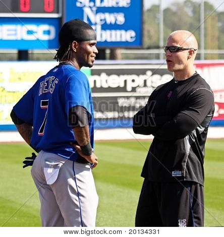 PORT ST. LUCIE, FLORIDA - MARCH 24: NY Mets shortstop Jose Reyes (L) chats with team physical therapist, John Zajac during spring training on March 24, 2010 in Port St. Lucie, FL.