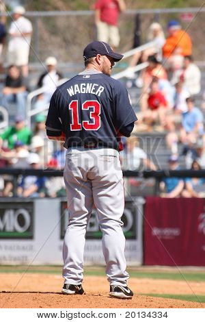 PORT ST. LUCIE, FLORIDA - MARCH 23: Atlanta Braves pitcher Billy Wagner gets set during a spring training game against the NY Mets in Port St. Lucie, FL on March 23, 2010.