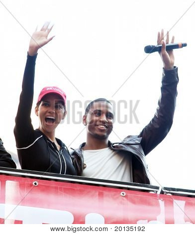 NEW YORK - MAY 1: Halle Berry and Trey Songz wave to the crowd at the 13th Annual Entertainment Industry Foundation Revlon Run/Walk for Women in Times Square on May 1, 2010 in New York City.