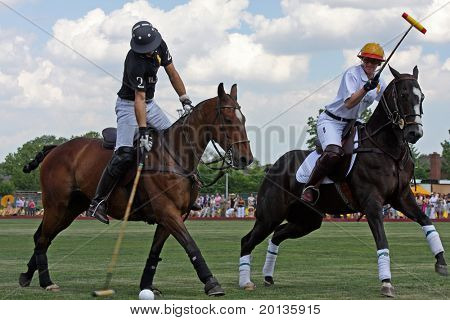 NEW YORK - MAY 30: Argentine polo player Nacho Figueras (L) competes in the Veuve Clicquot Manhattan Polo Classic at Governors Island on May 30, 2009 in New York City.