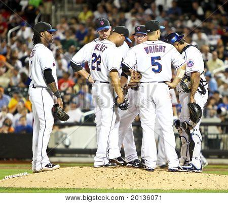 FLUSHING - JULY 30: New York Mets players Ike Davis, Jose Reyes, David Wright, and Dan Warthen plays baseball at CitiField Park against the Arizona Diamondbacks on July 30, 2010 in Flushing, New York.
