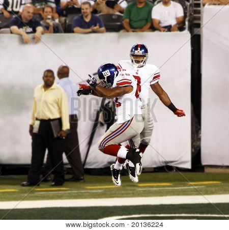 EAST RUTHERFORD, NJ - AUGUST 16: New York Giants wide receiver Victor Cruz and Jerome Johnson celebrate in the endzone at  Meadowlands arena on August 16, 2010 in East Rutherford, New Jersey.