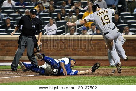 FLUSHING, NY - SEPTEMBER 15: New York Mets catcher Henry Blanco and Pittsburgh Pirates catcher Chris Snyder during a baseball game at CitiField ballpark on September 15, 2010 in Flushing, New York.