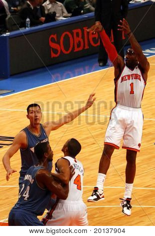 NEW  YORK - OCTOBER 17: New York Knicks forward Amar'e Stoudemire (1) shoots against the Washington Wizards at Madison Square Garden on October 17, 2010 in New York City.