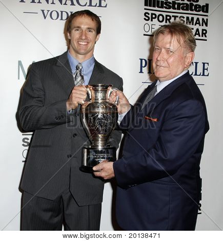 NEW YORK - NOVEMBER 30: Drew Brees and Terry McDonell attend the Sports Illustrated Sportsman of the Year Awards at the IAC Building on November 30, 2010 in New York City.