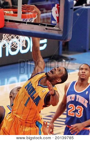 NEW YORK - MARCH 2: New Orleans Hornets forward Trevor Ariza (1) dunks a basket against the New York Knicks at Madison Square Garden on March 2, 2011 in New York City.