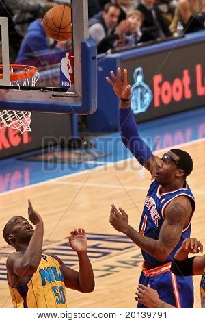 NEW YORK - MARCH 2: New York Knicks forward Amar'e Stoudemire (1) scores a basket against the New Orleans Hornets at Madison Square Garden on March 2, 2011 in New York City.