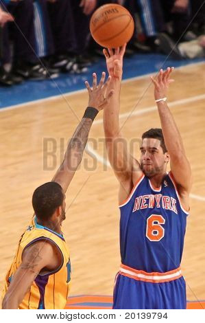 NEW YORK - MARCH 2: New York Knicks guard Landry Fields (6) shoots the ball against the New Orleans Hornets at Madison Square Garden on March 2, 2011 in New York City.