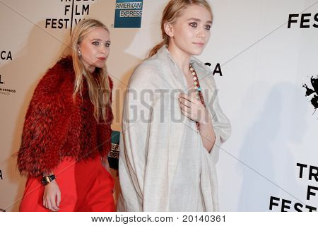 NEW YORK - APRIL 20: Mary-Kate and Ashley Olsen attend the opening night premiere of