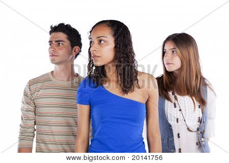 Three teenagers friends looking to there right side to the copy space (isolated on white)