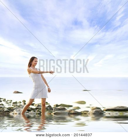 Young sexy woman stands in the water