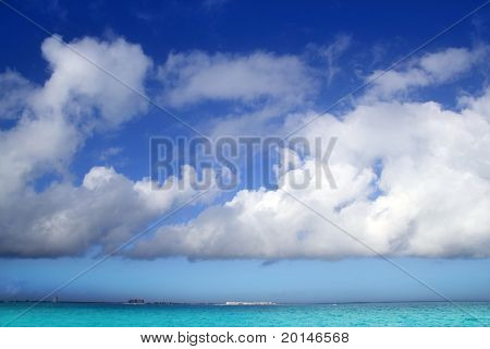 Cumulus clouds over caribbean turquoise perfect sea