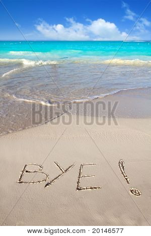 Bye spell written in beach sand tropical Caribbean end of vacation