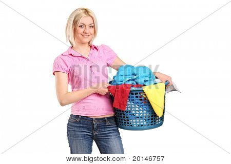 A young woman carrying a laundry basket isolated on white background