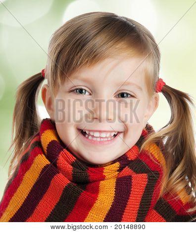 little girl in striped scarf