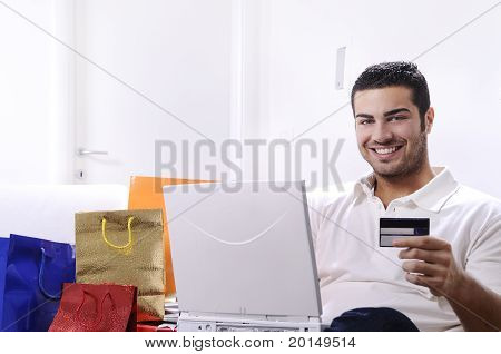 young man in shopping online