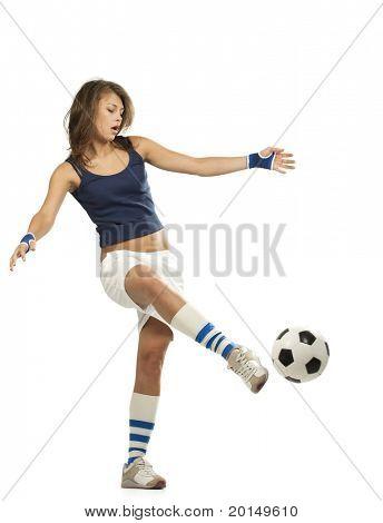 Girl Kicks soccer ball. Active lifestyle.