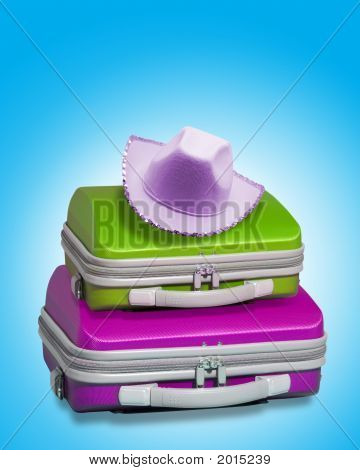 Two Colouyrful Suitcases With Hat